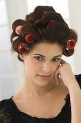 Portrait of a woman with hair curlers in her hair