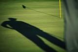 Golfer scopes putt poster
