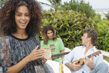 Woman with her friends playing musical instruments