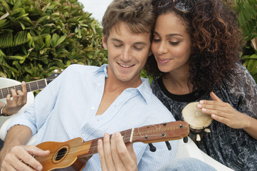 Couple playing musical instruments