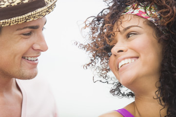 Close-up of a couple smiling at each other