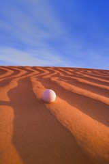 Golf Ball on Sand Dune Great Sand hills Sceptre Saskatchewan Canada
