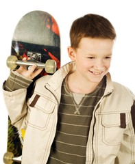 Young boy holding skateboard