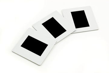 Three slides with plastic frames