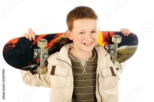 Young boy with skateboard - 13947939