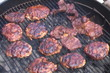 Glazed hamburger patties on BBQ grill - 16:9 anamorph