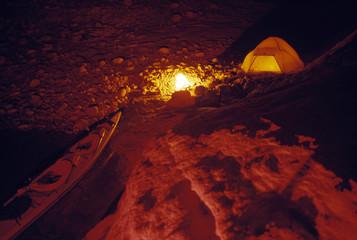 Campsite and kayak at night