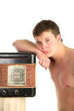 Retro tape recorder and the beauty of the male body