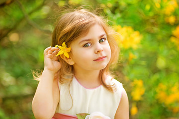 Child with flower in her hair