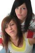 Studio shot of two trendy teen girls