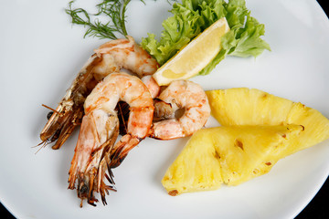 Fried shrimps decoration pineapple and greenery
