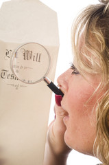 woman inspecting last will and testament