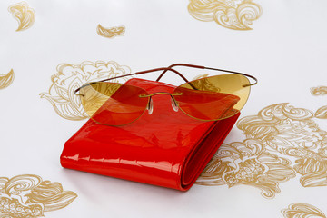sunglasses and purse on stylish scarf