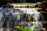 beautiful cascading waterfall captured with slow shutter poster