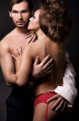 Emotive portrait of a young sexy couple