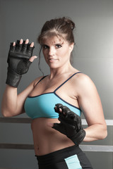 Mature female kick boxer