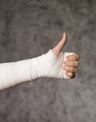 Person with bandage doing thumbs up