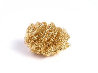 Sponge of bronze on white background