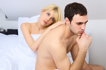 relationship difficulties of a couple in bedroom, focus on male