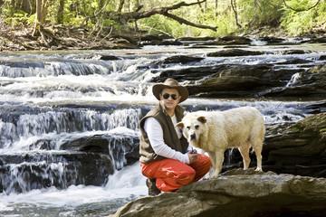 Man and Dog in River Looking at Camera