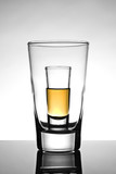 Shot glass placed in a beer glass