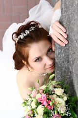 Bride near wall