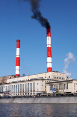 Power plant with the black fume from the red smoke stack