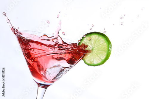 red cocktail with lime on white - 14018926