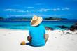 Man looking at coral island of Okinawa