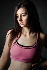 Shot of a Sporty Girl in Pink Top Looking off Camera