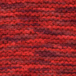 Red colors knitted wool line close up.