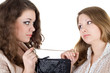Two beautiful girls and one handbag. Isolated
