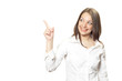 Young woman in white shirt specifies with finger to up-left