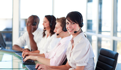 Motivated business team in  a call centre