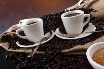 Fresh brewed coffee on grains and sisal sack