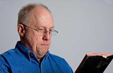 Older Serious Guy Reading Bible