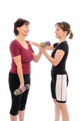 Senior woman exercising with coach