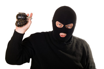 Terrorist with two grenades isolated on white.