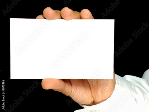 card in hand with black background 20509