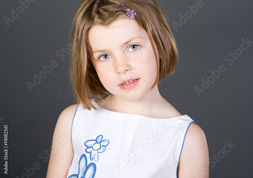Shot of a Cute Blonde Haired Child against Grey Background