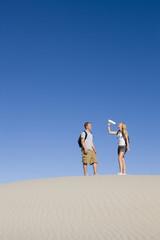 Hikers Drink Water in the Desert