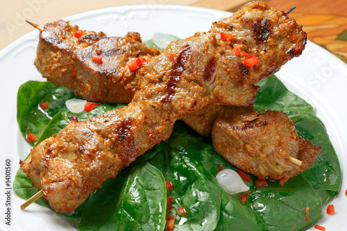 pork kebab with spice and salad