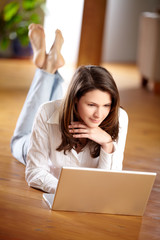 young women with laptop thinking about