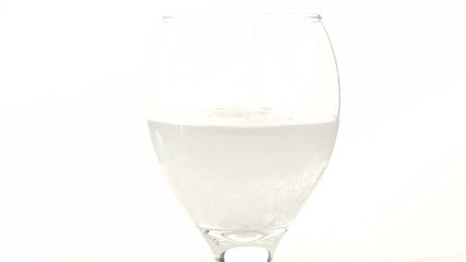Sparkling water pour into stem glass - HD