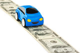Toy car on money road
