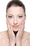 Stroking face skin poster
