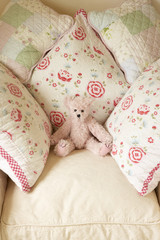 Cushions On Chair With Teddy Bear