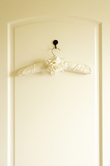 Coat Hanger On Back Of Door