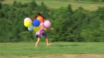 Girl Skipping with Balloons