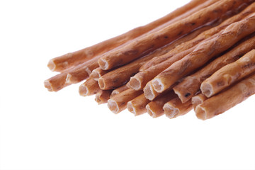slated beer snack -baked sticks isolated on white